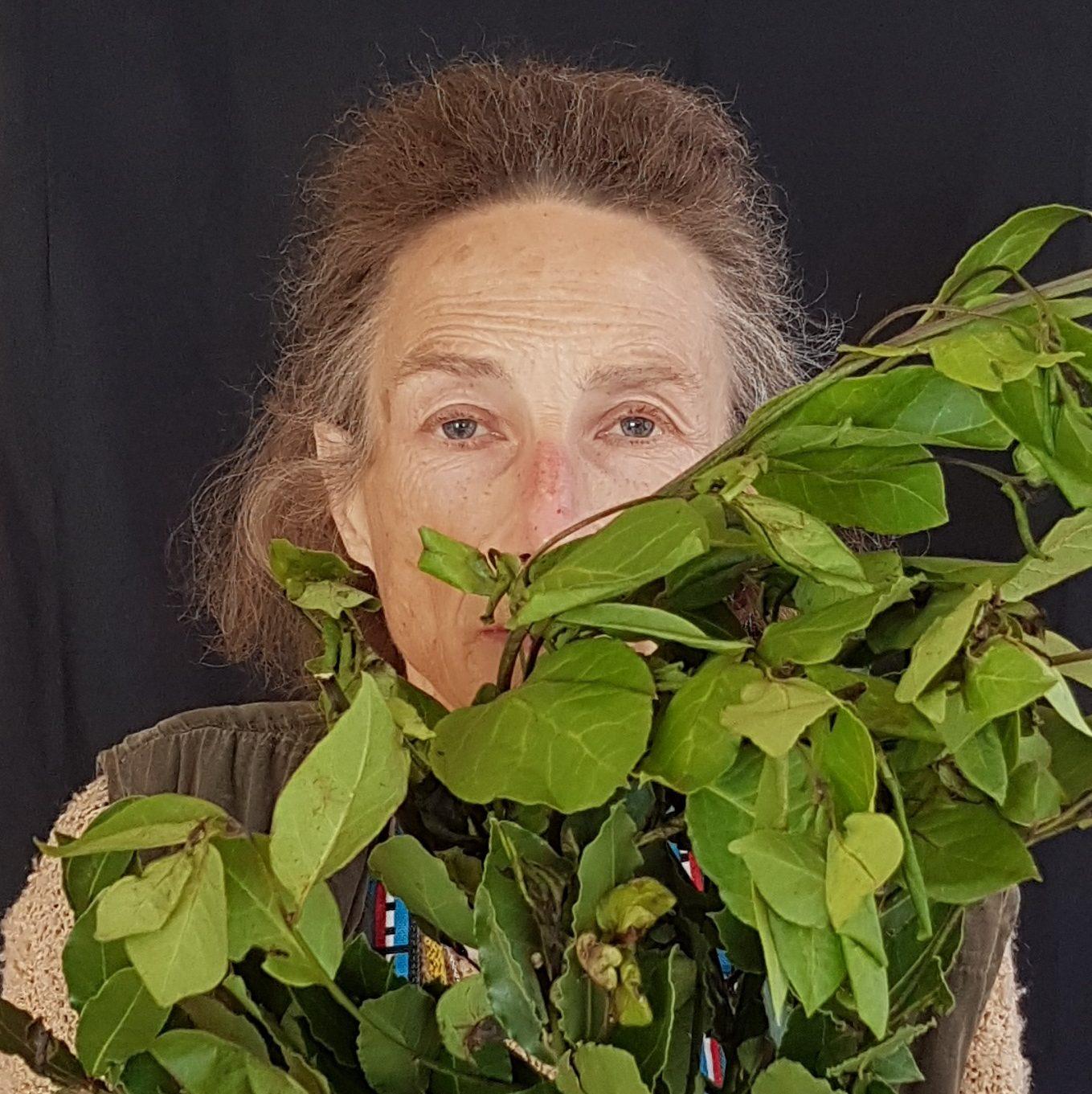 Rose behind her vegtabless