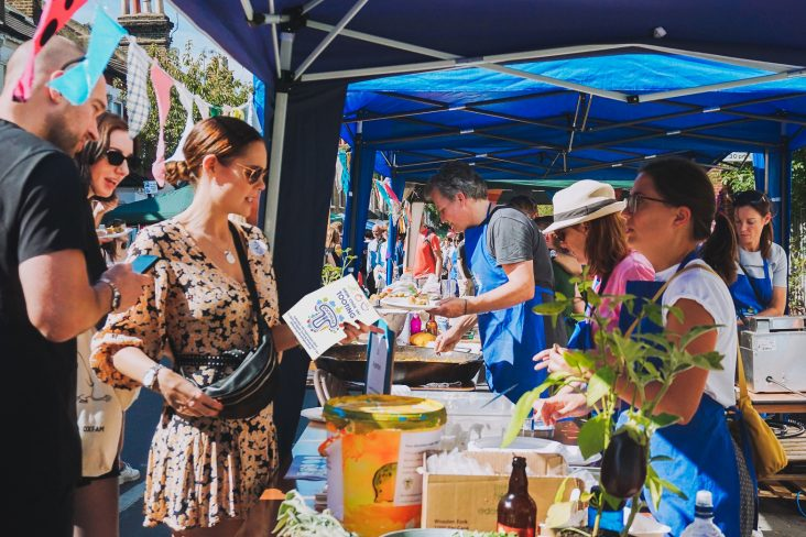 People engaged at Foodival stall in Tooting